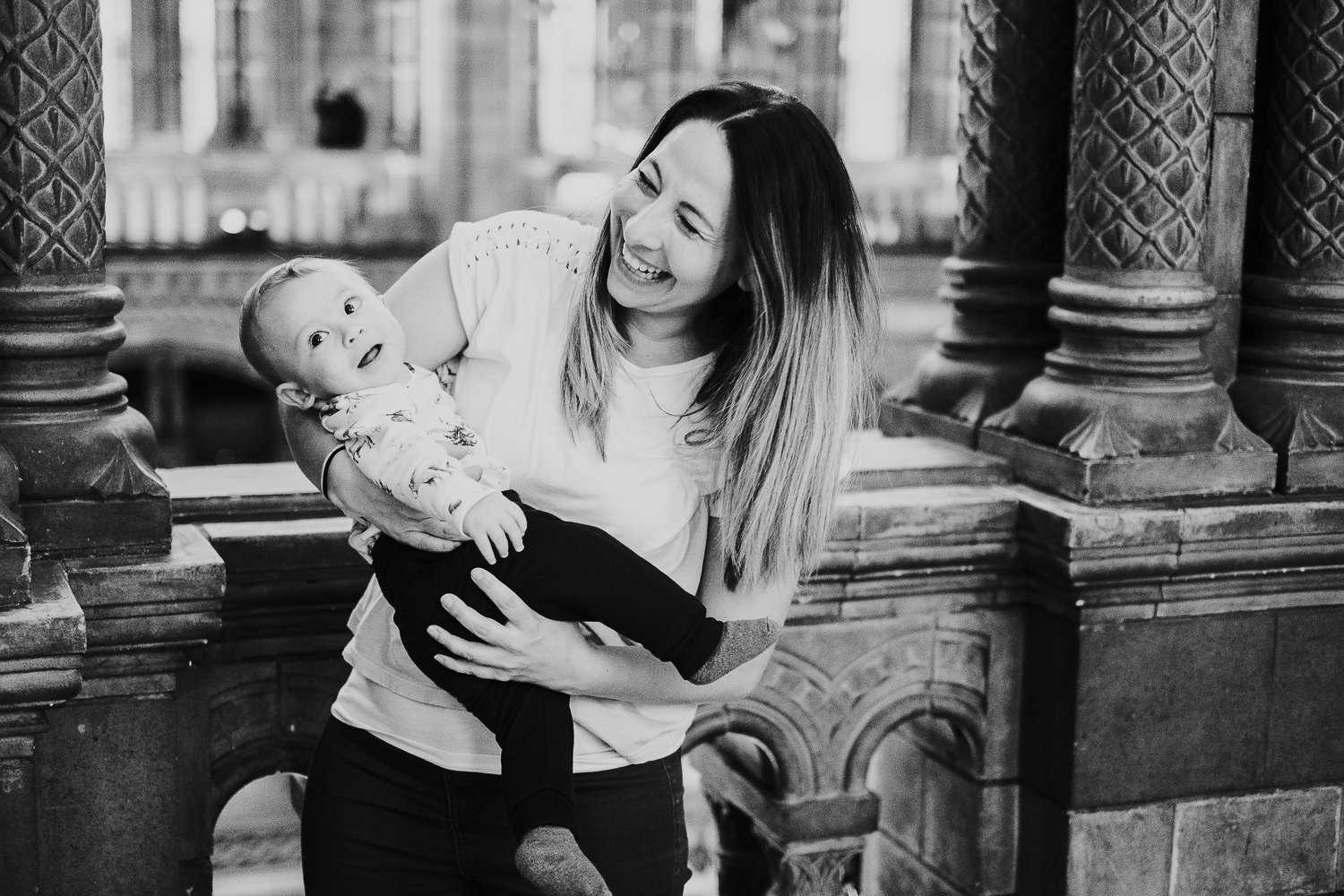 mum and baby son playing upstairs at Hintze Hall at the natural history museum family photography