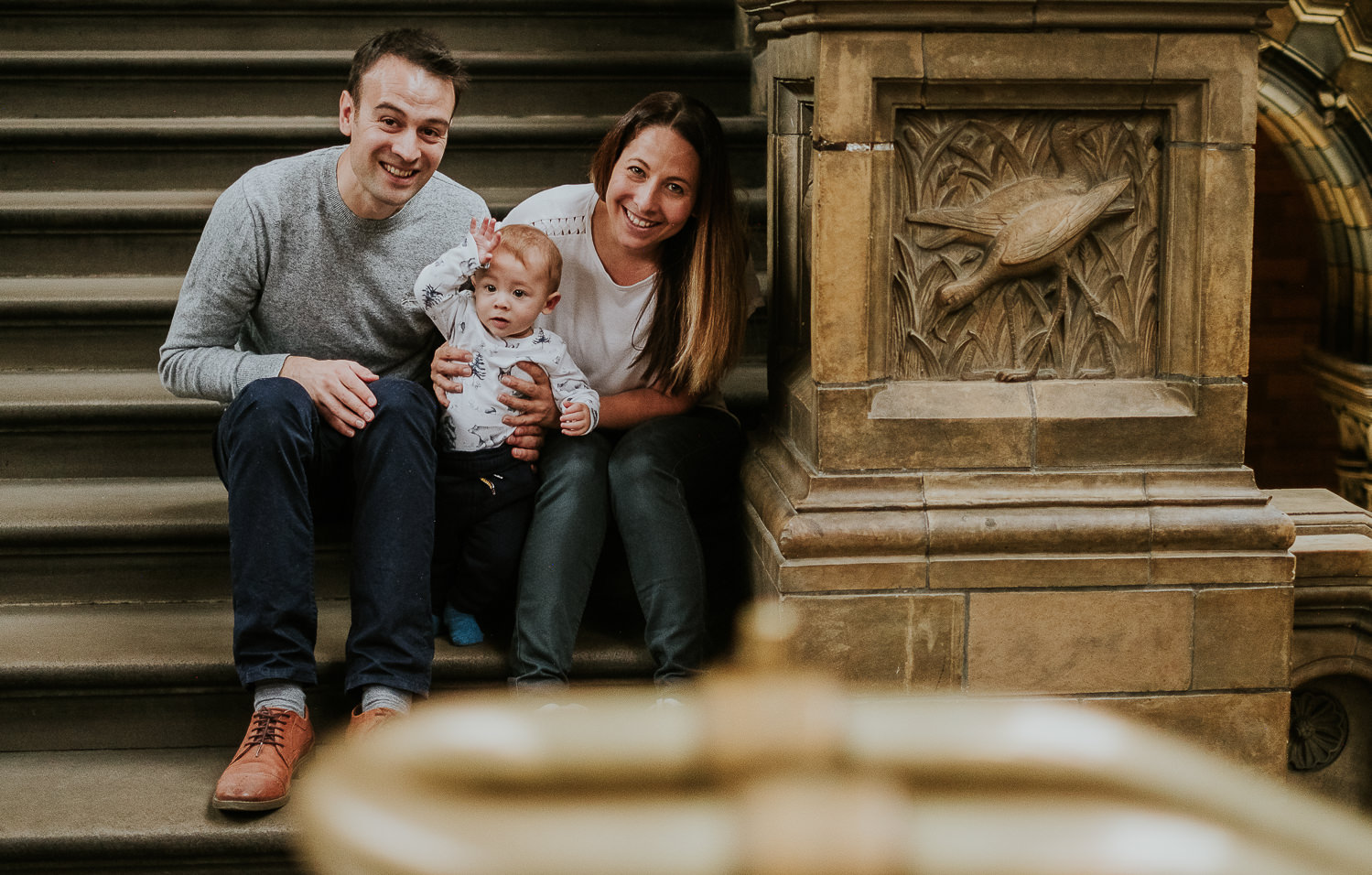 portrait of family sitting on steps at the natural history museum family photography