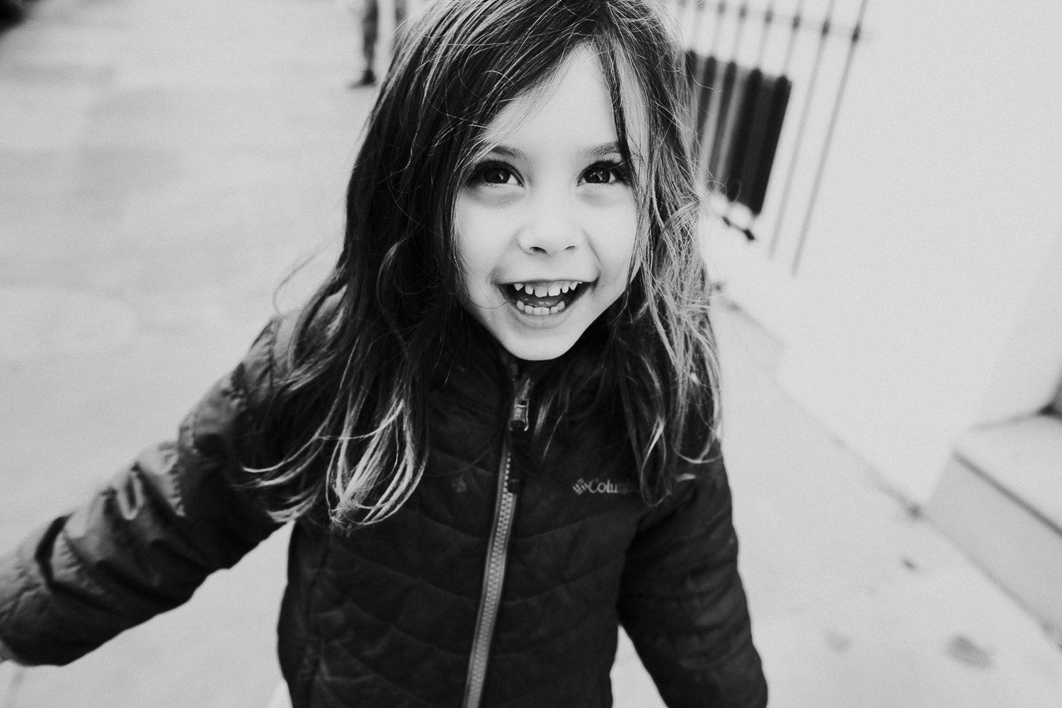 notting hill family photographer close up photo of young girl grinning in the street
