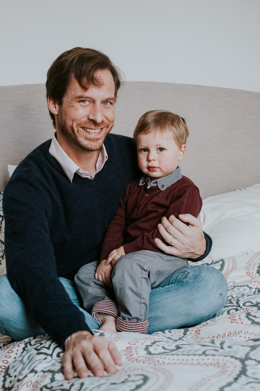 notting hill family photographer father and son portrait sitting on bed