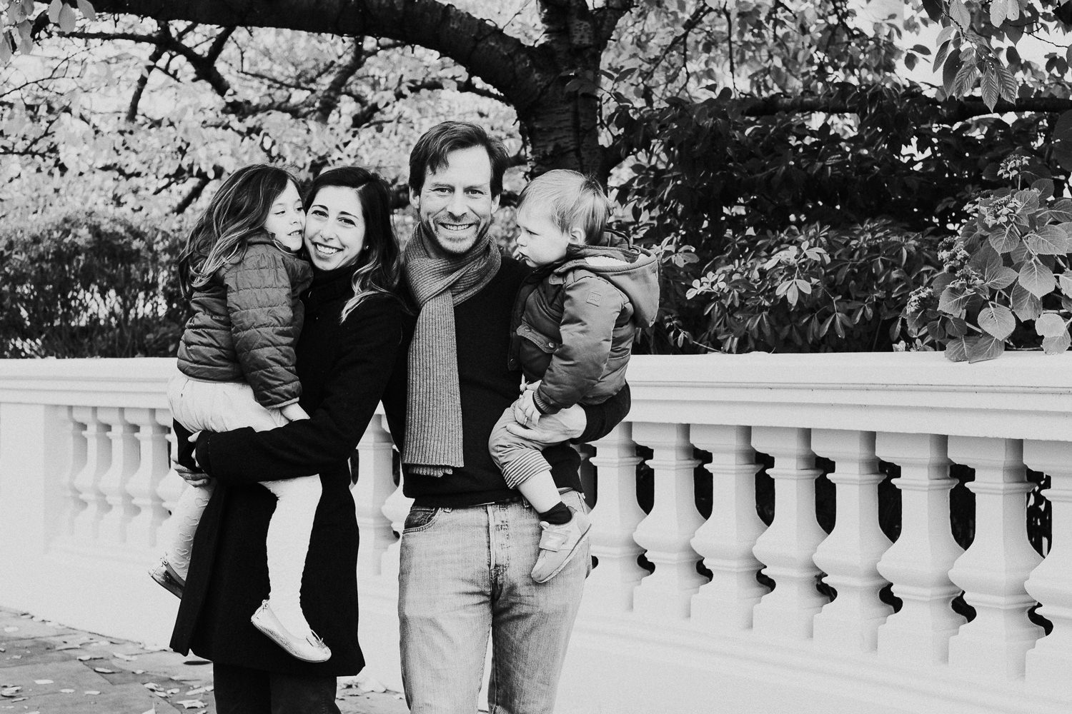notting hill family photographer black and white portrait outdoors by autumn tree