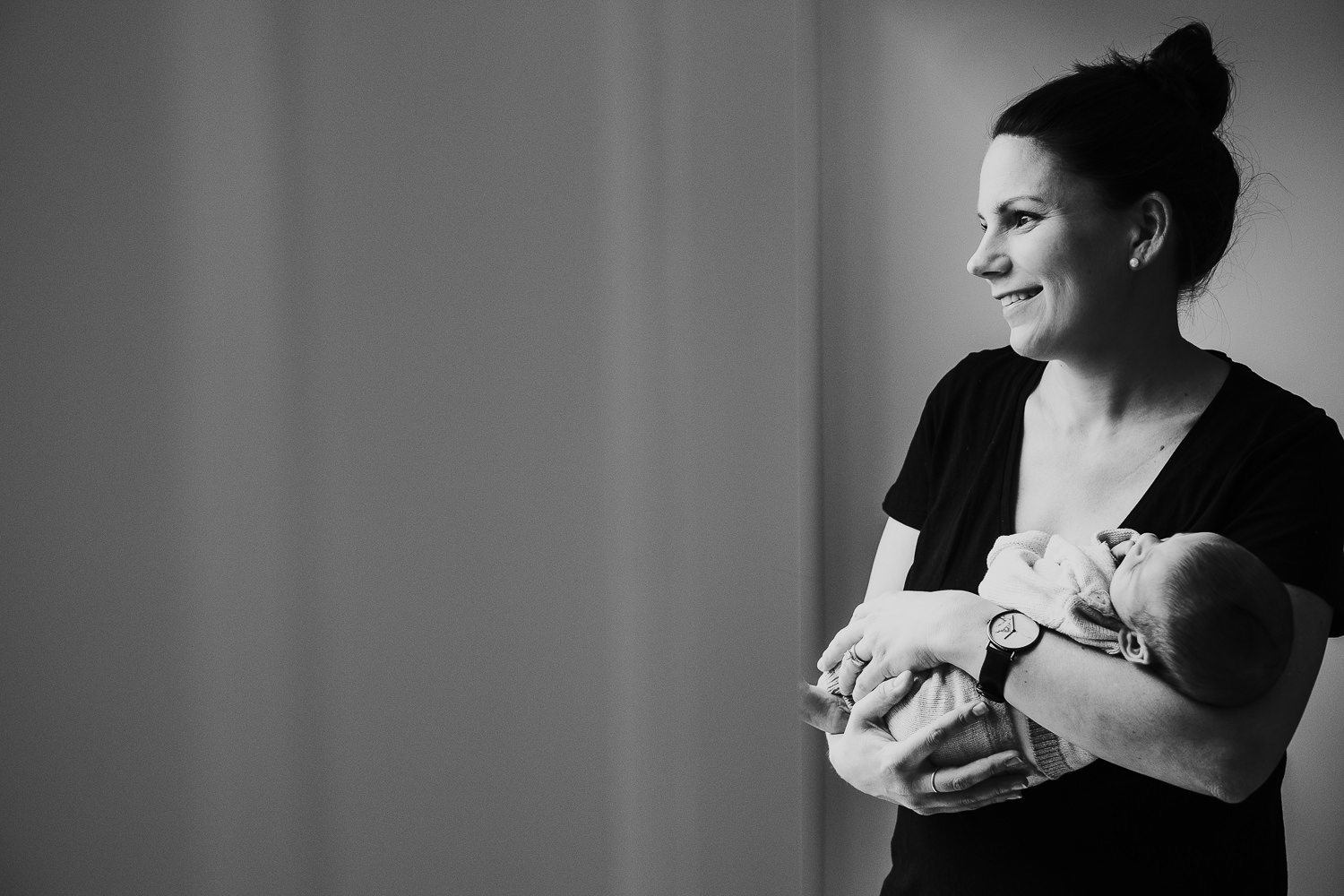mother holding baby son black and white photo london newborn photography