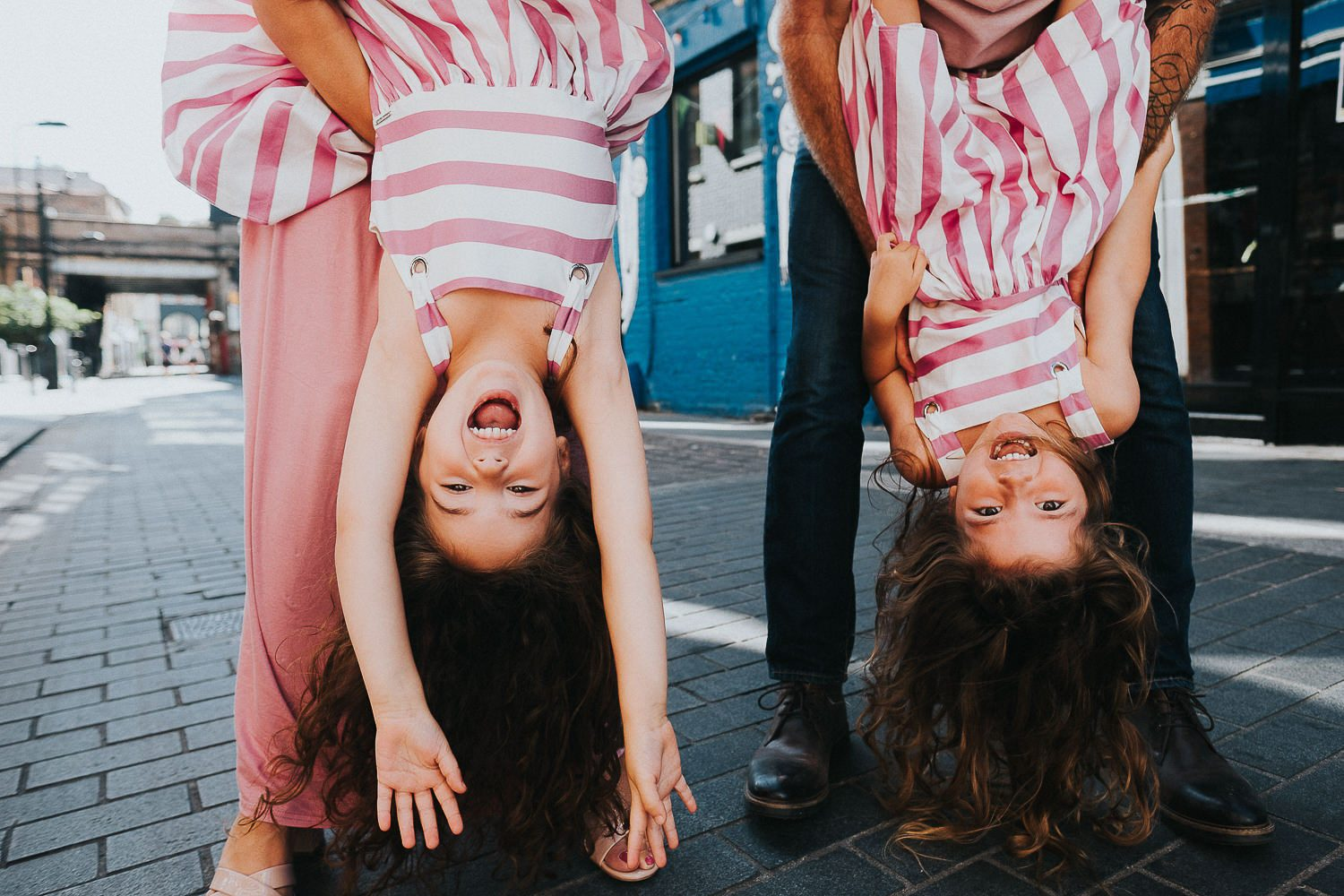 5 reasons you shouldn't wear matching outfits for your family photos. Twin girls upside down.
