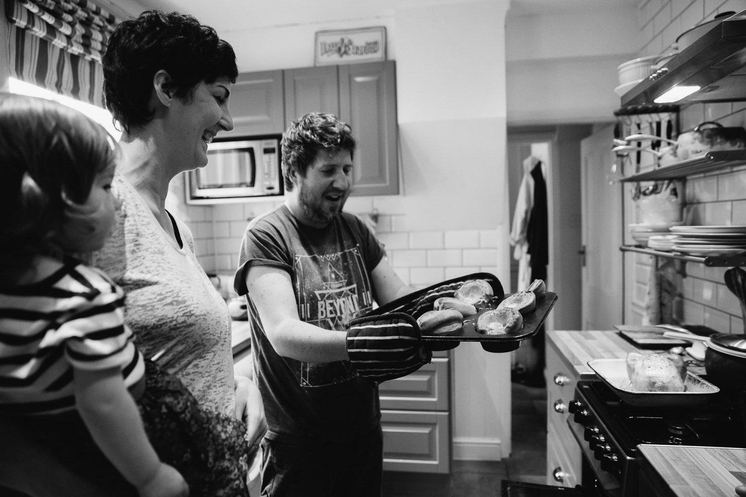 day in the life photography mum and dad in kitchen cooking black and white image