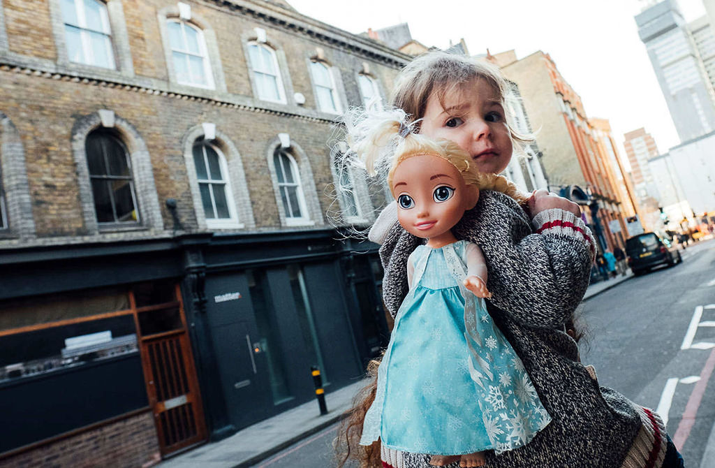 toddler with doll in London