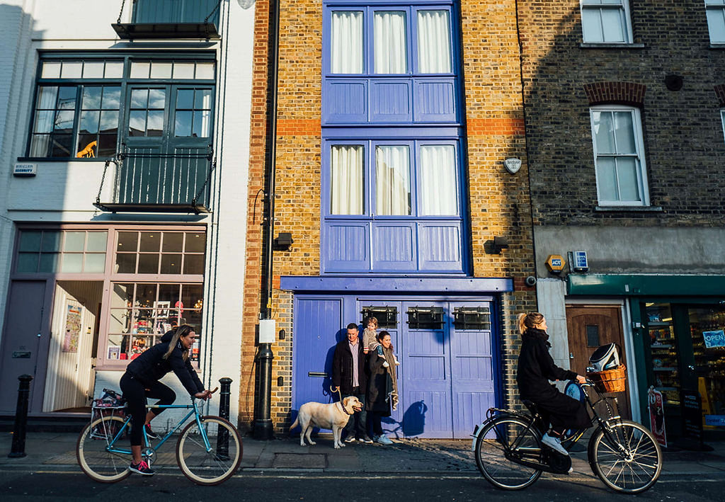 london family photographs family on street with dog and bikes
