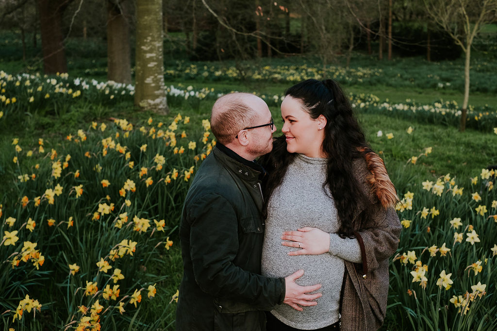Maternity photographer Kent - couple in Spring countryside