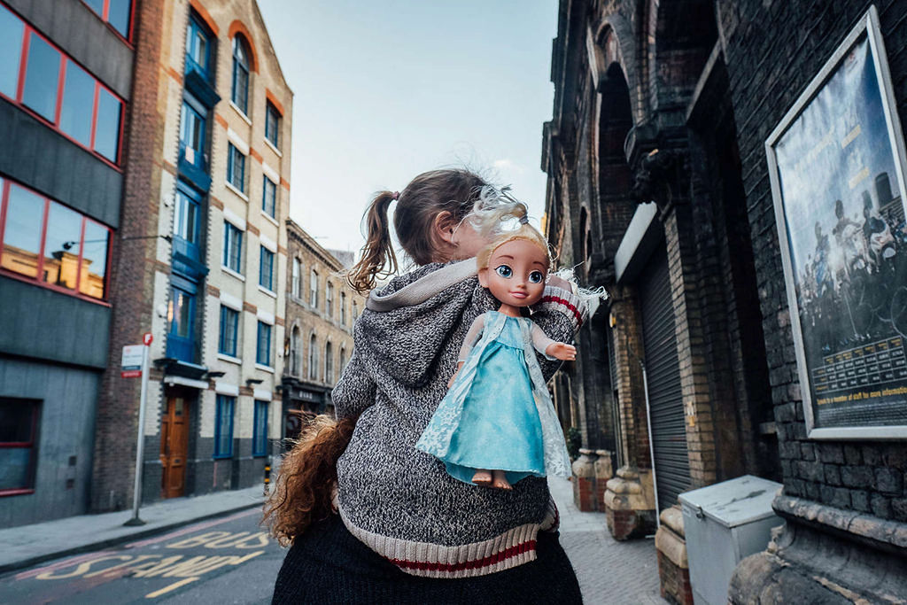 Toddler girl with Elsa doll in London