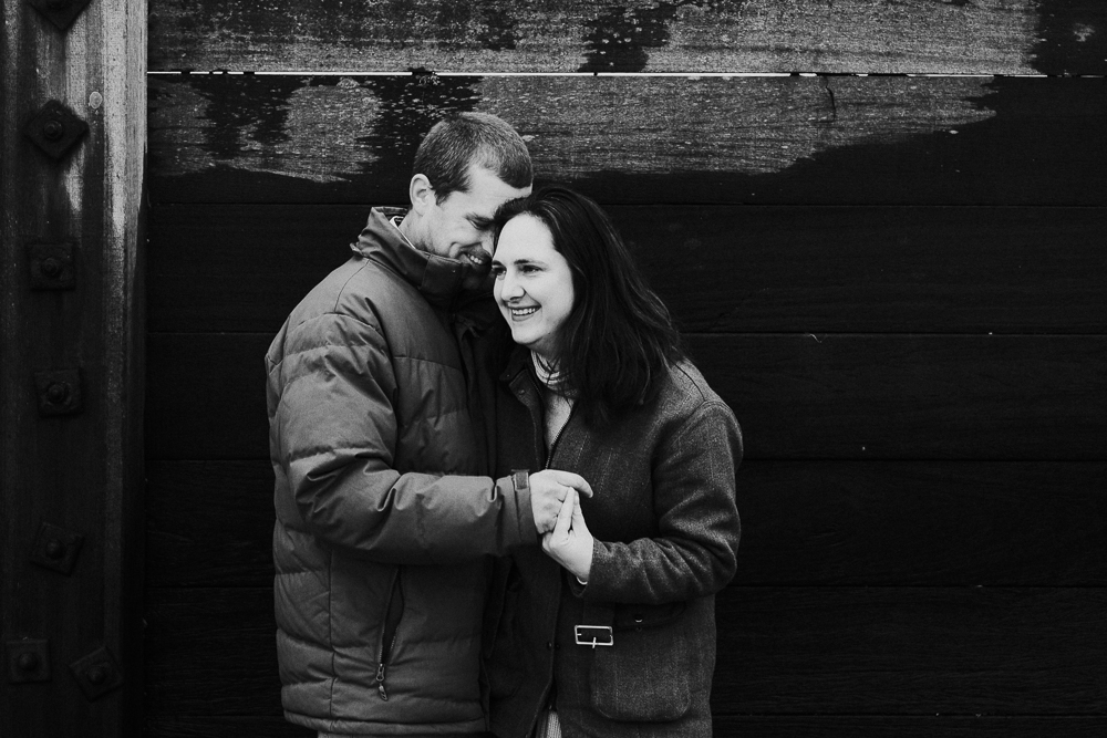 Black and white beach portrait husband and wife. Kent Christmas Mini Photo Shoots