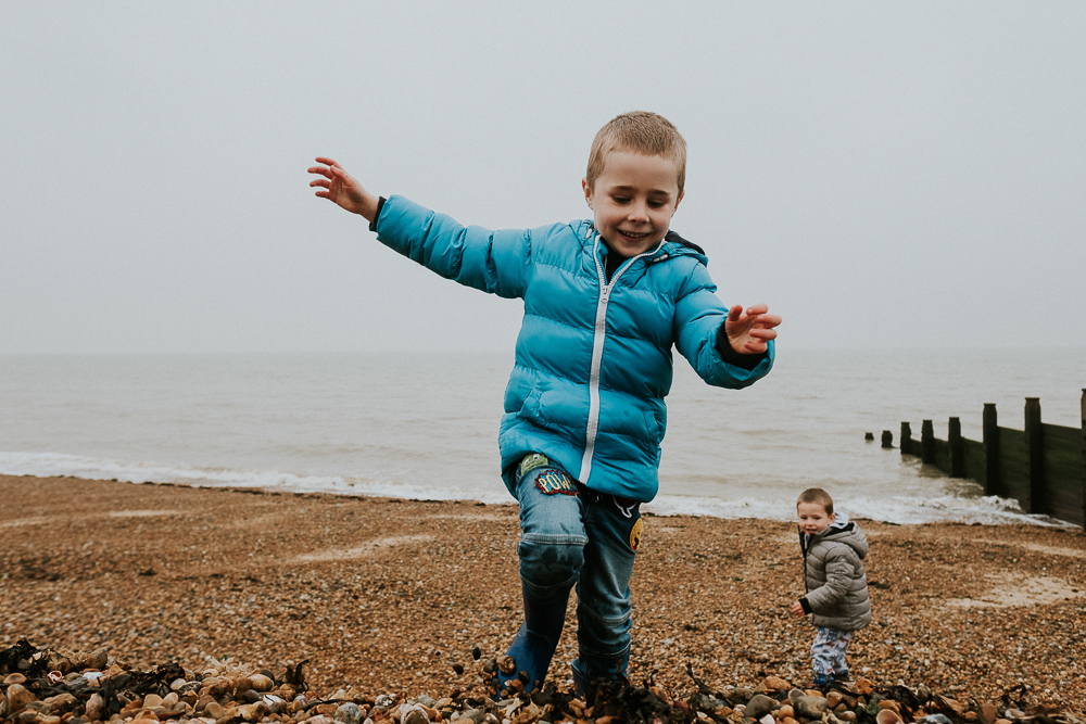 Kent Christmas Mini Photo Shoots Whitstable Beach boy playing