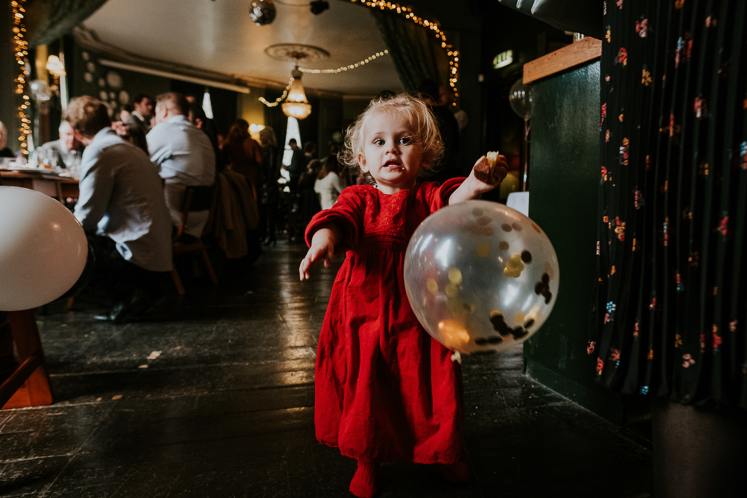 london christening photography toddler girl with giant balloon