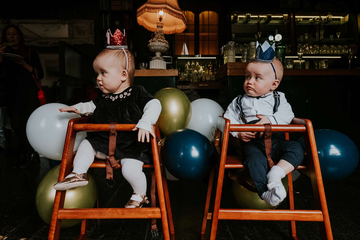 london christening photography two babies with party hats