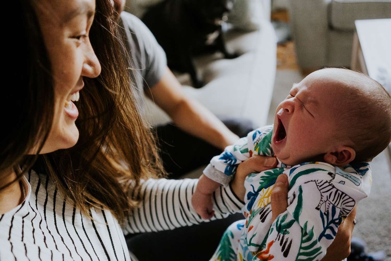baby yawning newborn photo session at home