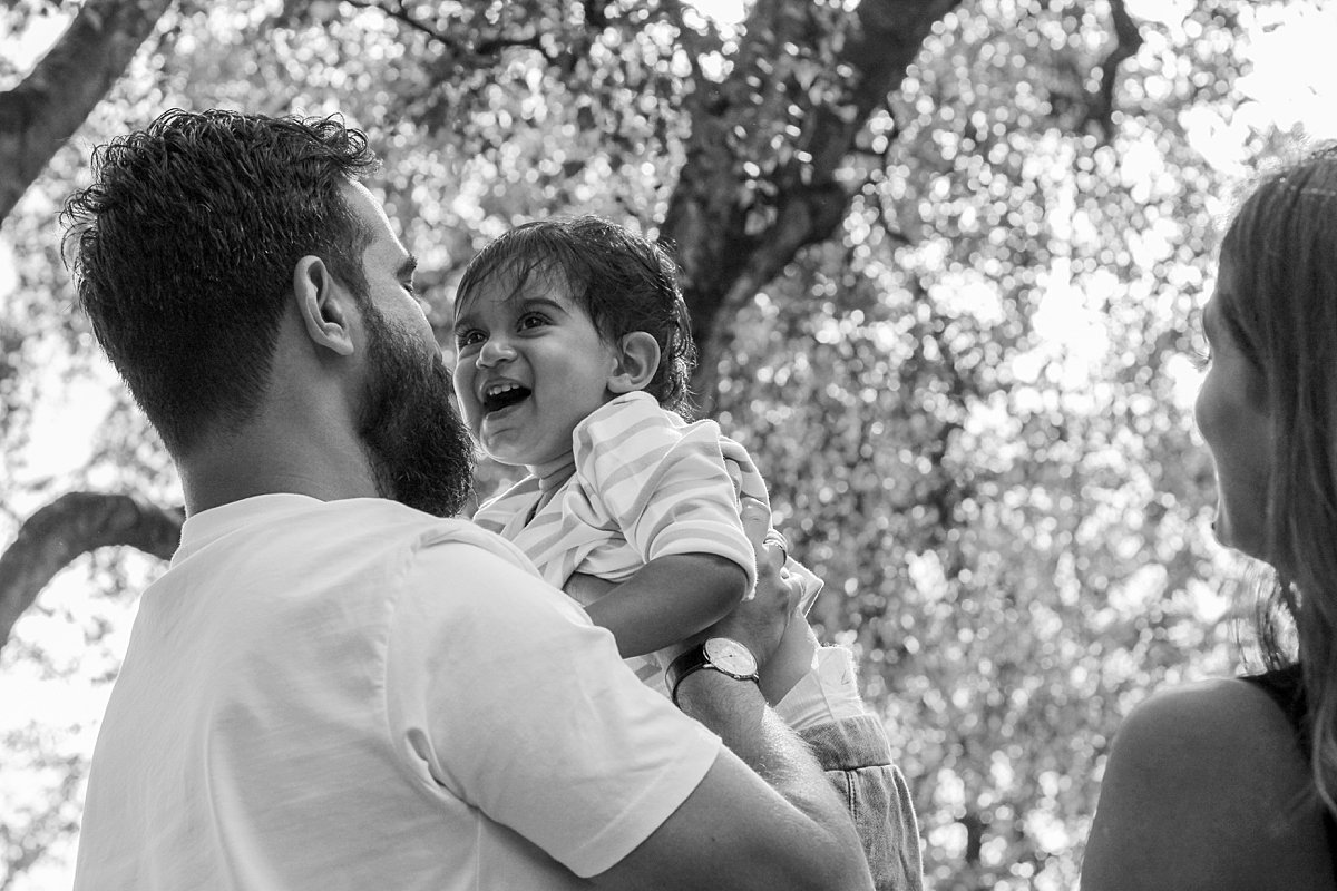 outdoor mini photo shoots in london black and white portrait of father and baby son