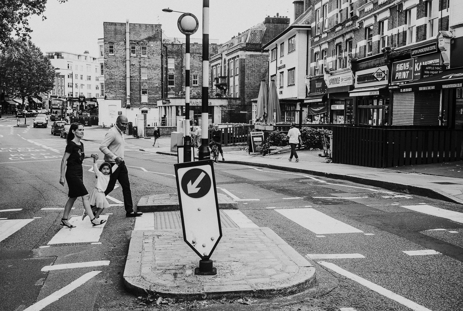 London family photography 2020 black and white photo of parents and young girl pedestrian crossing