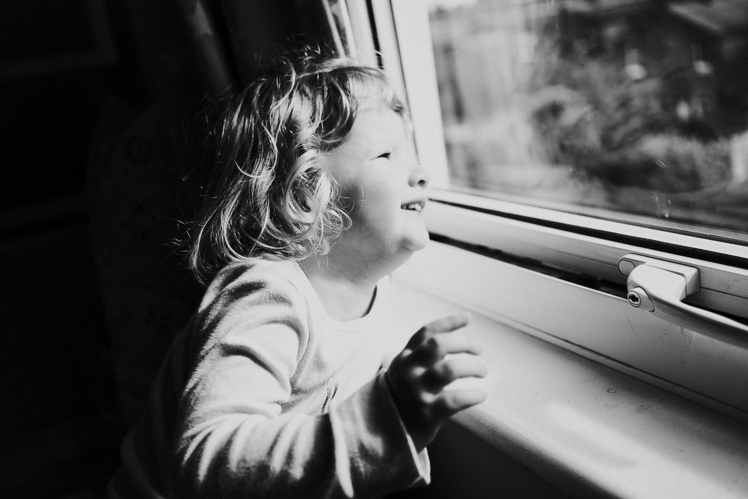 sibling family photography 2020 black and white portrait young girl at window