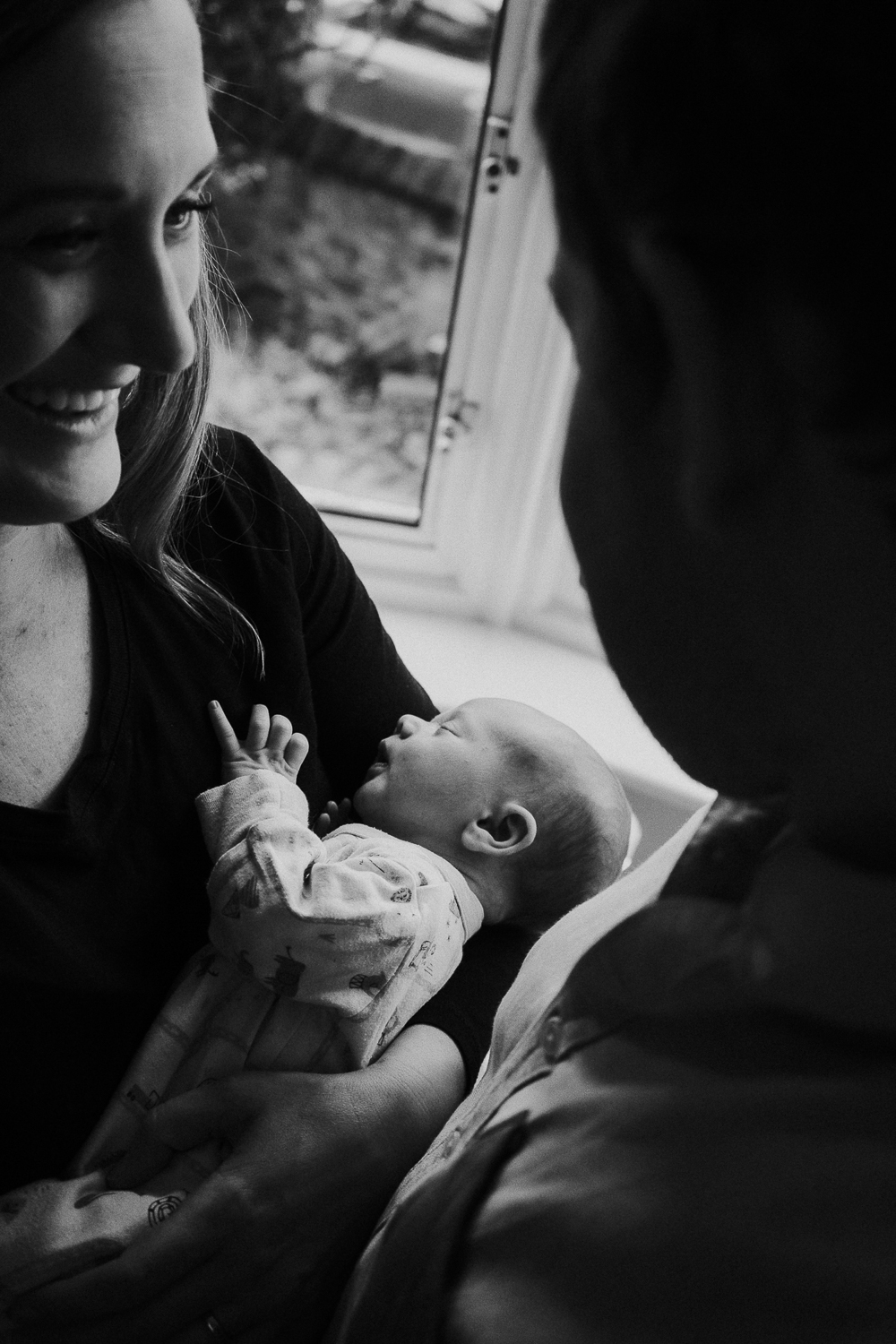London family photography 2020 black and white parents with newborn