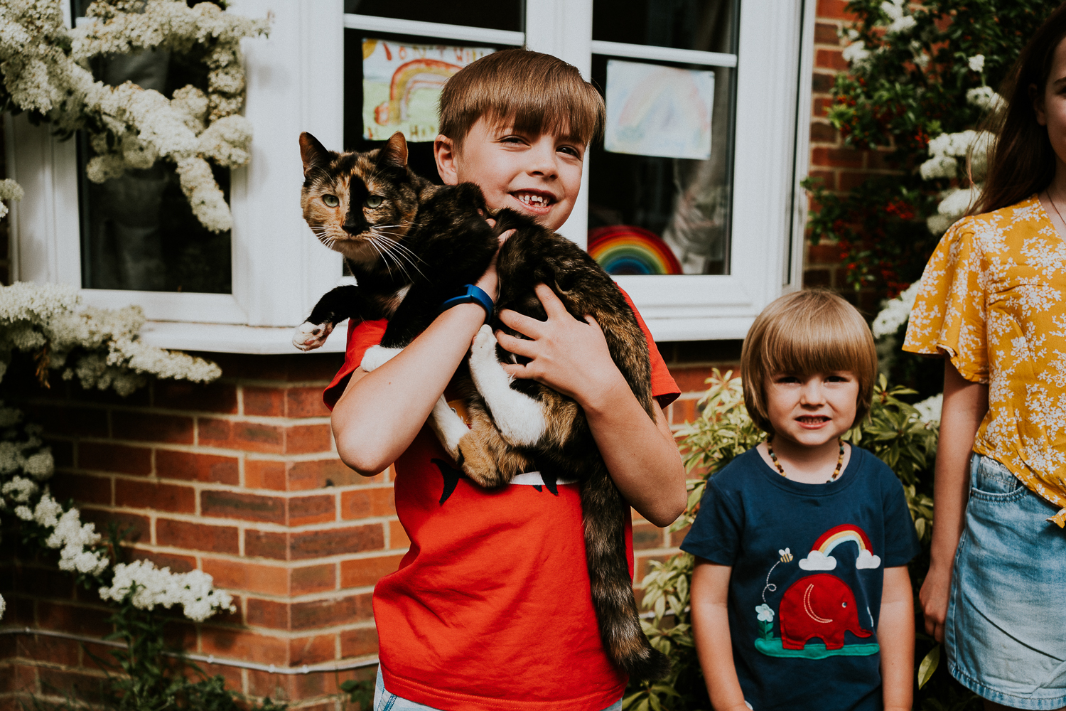London family photography 2020 doorstep shoot portrait in kent boy with cat