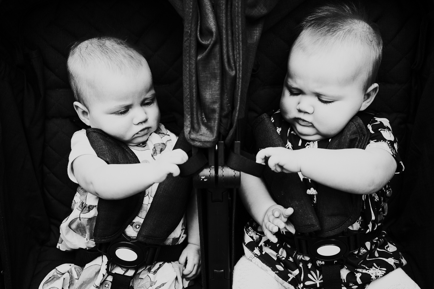 day in the life photo shoot twin baby girls in double pushchair black and white photo