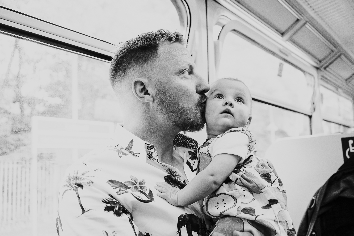 day in the life photo shoot father and baby girl on train black and white shot