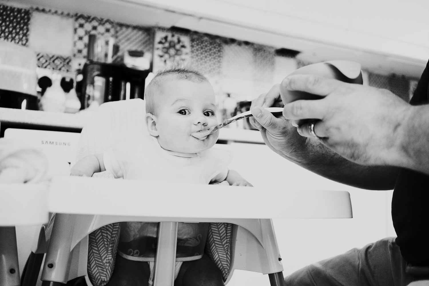 day in the life photo shoot baby girl in highchair black and white photo