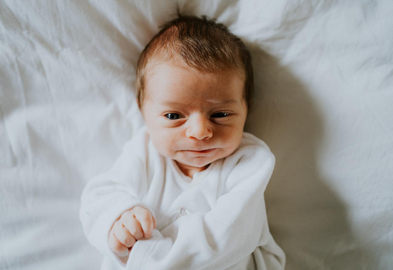 east london newborn photographer baby lying on bed