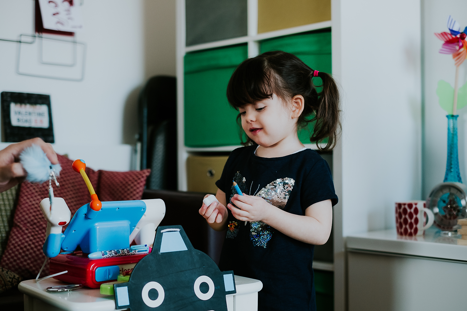 home scene of little girl playing with make believe toys islington family photographer shoot