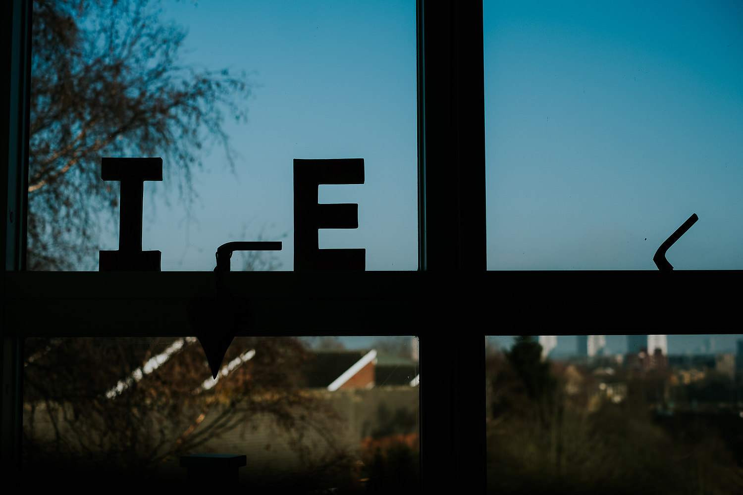 capital I and E for children's names on window at home islington family photographer