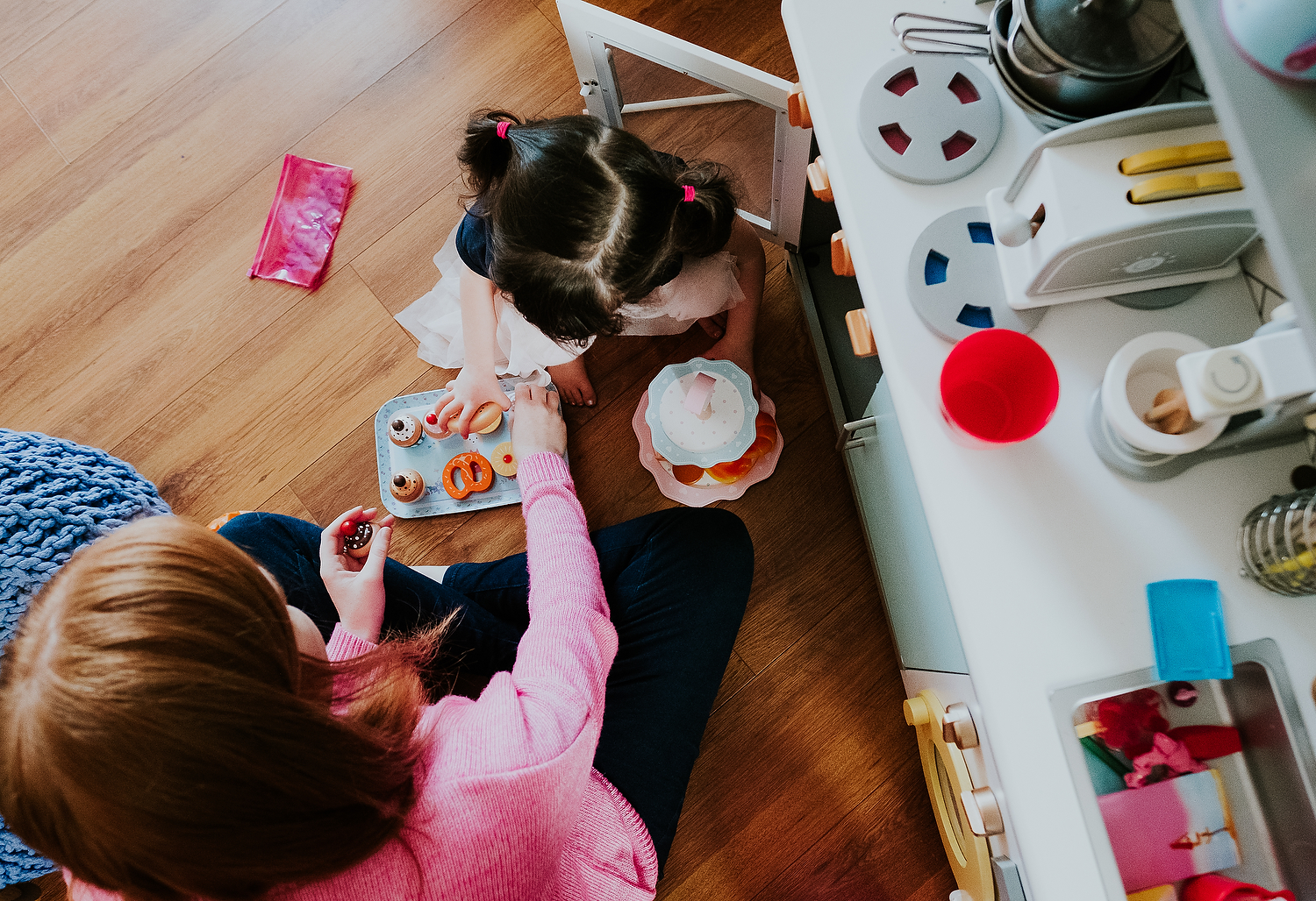 aerial shot of mother and daughter playing make believe with tea set islington family photographer