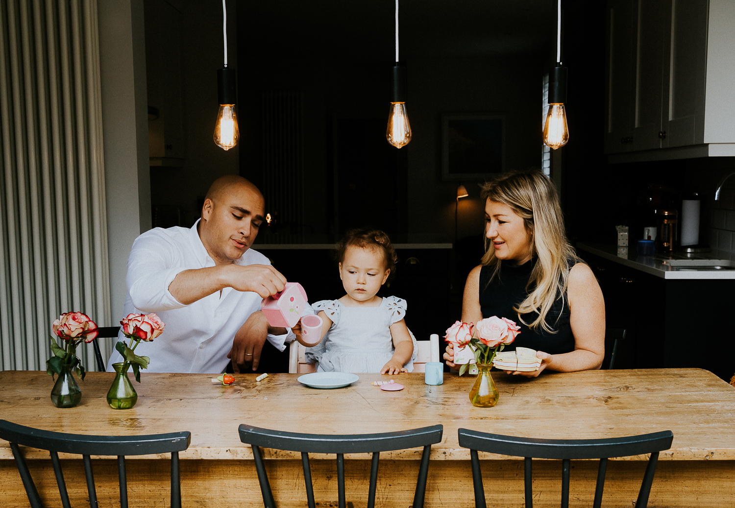 NORTH KENSINGTON FAMILY PHOTO SESSION parents and toddler daughter playing tea time in modern family home