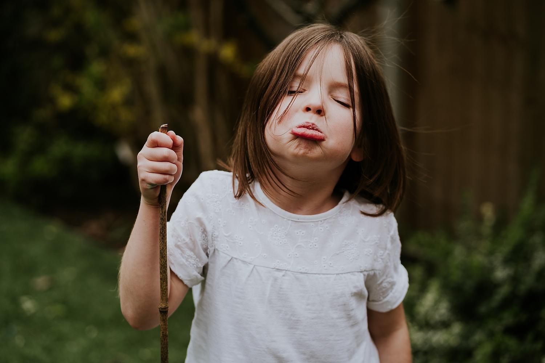 REAL LIFE FAMILY PHOTOS LITTLE GIRL IN GARDEN GRUMPY FACE