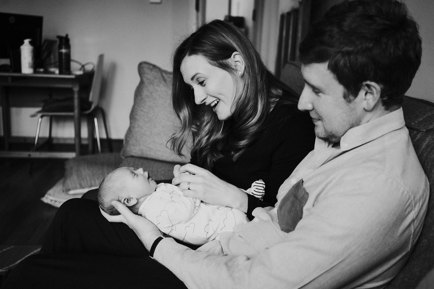 newborn photo session at home in highgate black and white photo of baby boy with parents