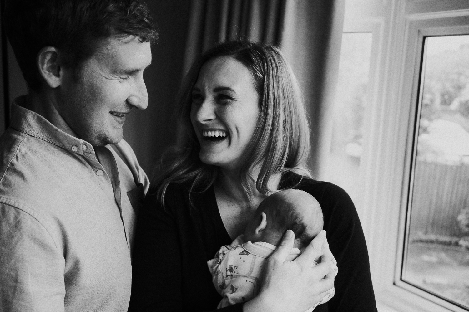 newborn photo session at home in highgate black and white photo of baby boy and parents