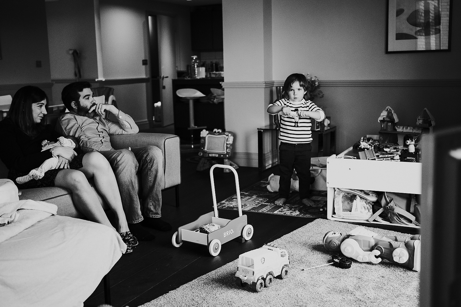 black and white family living room scene newborn photography in hammersmith